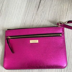 Kate Spade wristlet with gold zipper